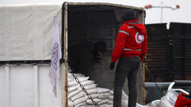 Aid trucks bring relief to starving Syrians