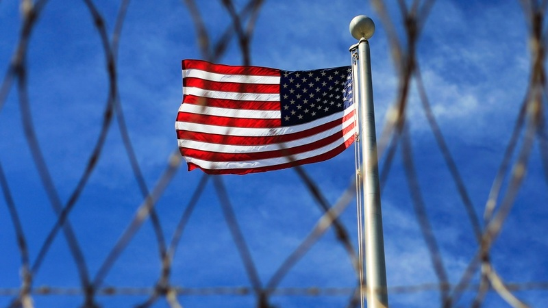 U.S. to transfer 34 Gitmo prisoners by summer