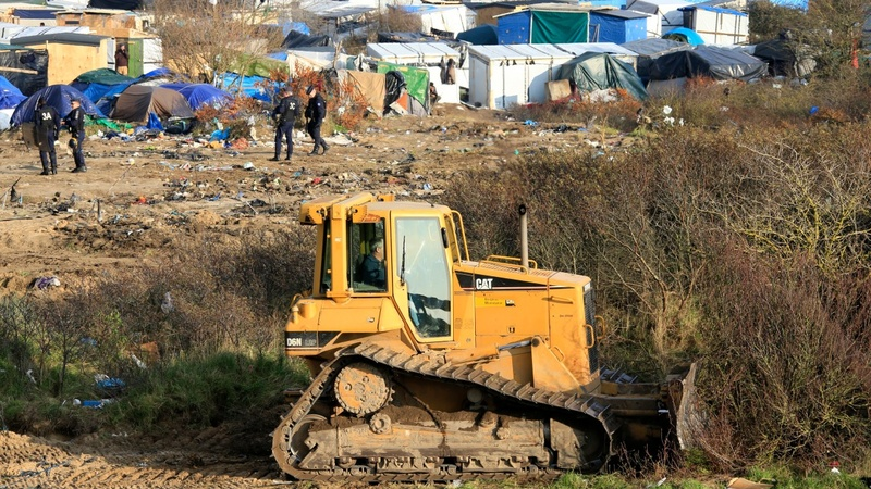 Bulldozers flatten parts of 'The Jungle' in Calais
