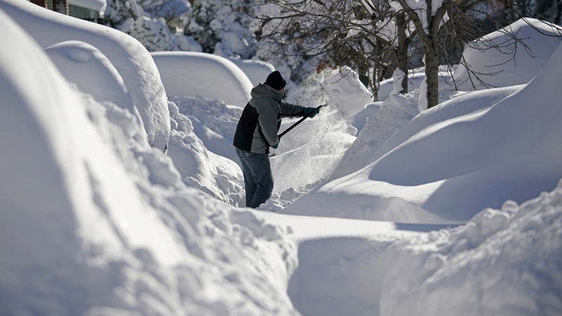 East coast digs out, shovel by shovel