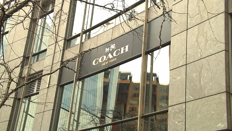 Coach breaks out of quarterly sales slump