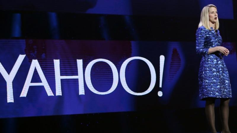 Yahoo to cut jobs, trim losses