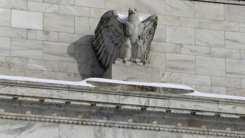 Dollar dives after Fed warning shot