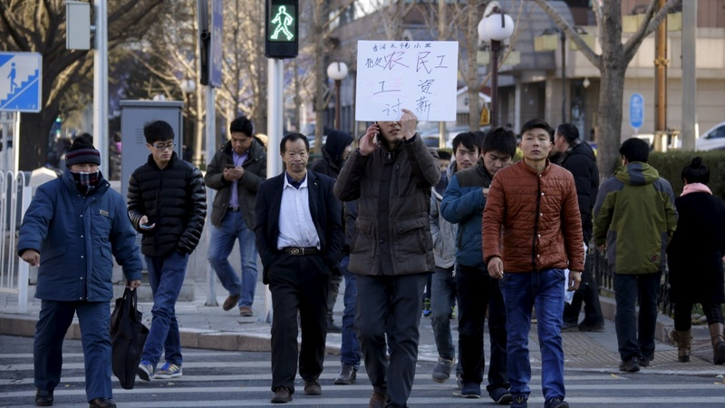 Angry unpaid workers skip China's big holiday