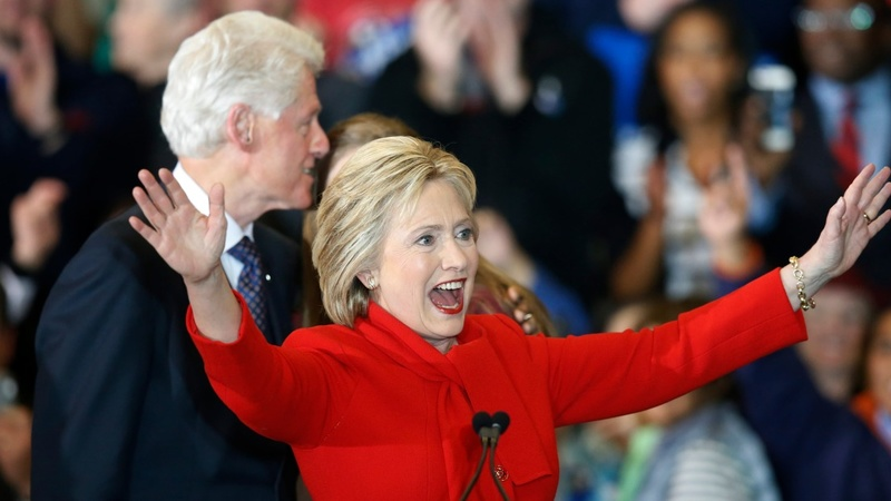 Clintons,  Sanders fight for women's vote on eve of NH