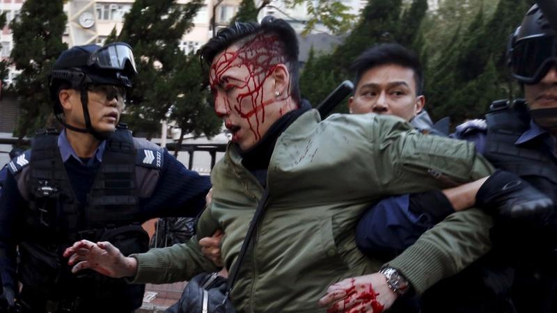 HK police fire warning shots in street clash