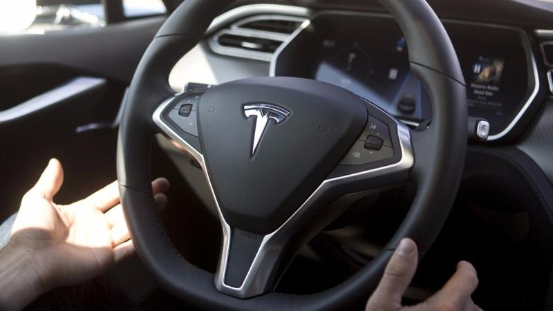 Tesla shares surge on promise of profits