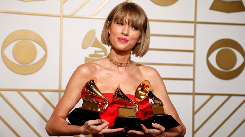 Swift and Lamar shine at the Grammys