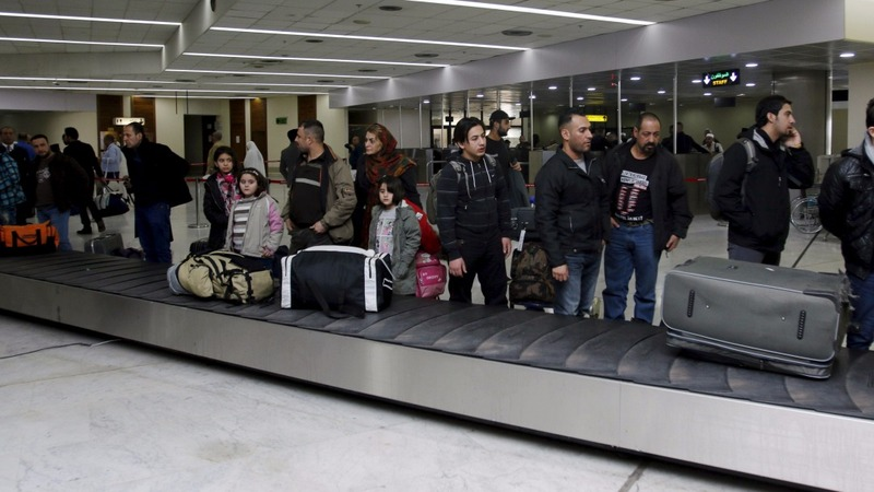 Iraqi refugees return to Baghdad from Finland