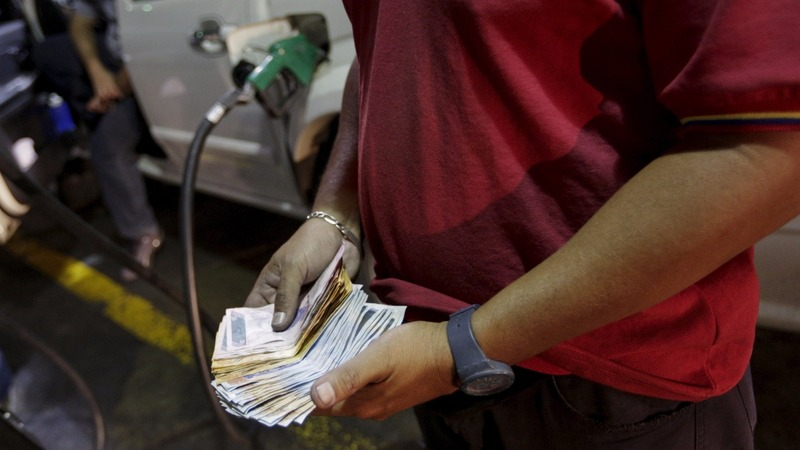 Venezuela hikes up gas prices, devalues currency