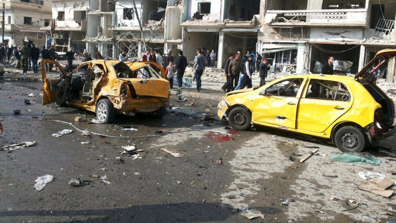 Twin car bombs kill dozens in Homs