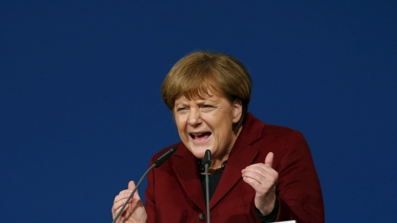 Merkel urges patience on migrants before vote