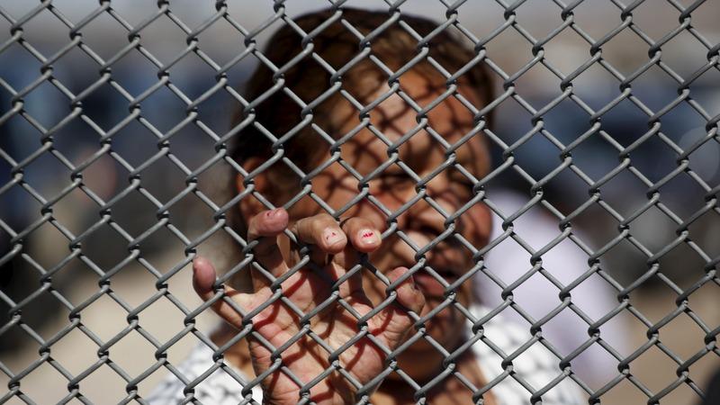 Trump's  'wall' talk sparks migrant rush into U.S.