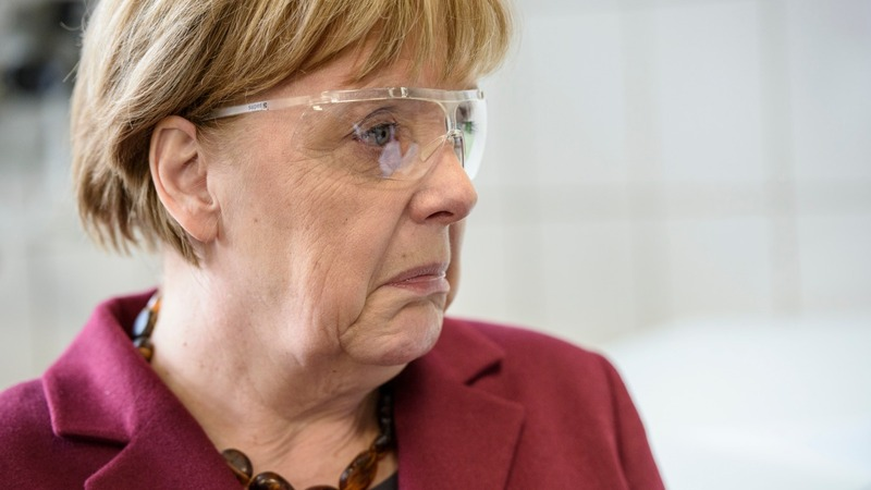 Merkel fights back as refugee influx slows