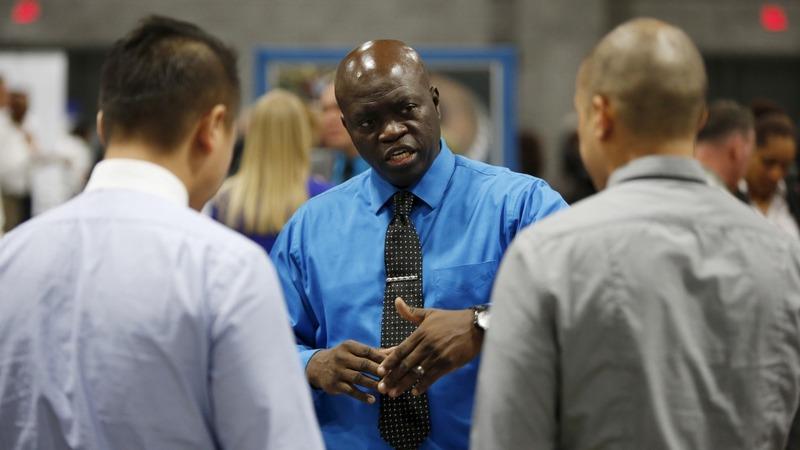 Sharp U.S. job gains defy global economic gloom