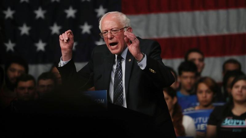 Sanders pulls off big Michigan upset