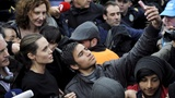 INSIGHT: Jolie mobbed on Greek migrant visit