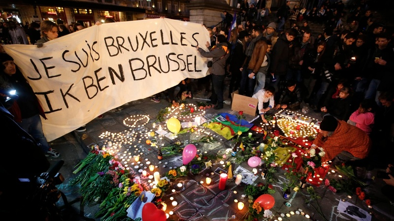 Brussels mourns as manhunt continues