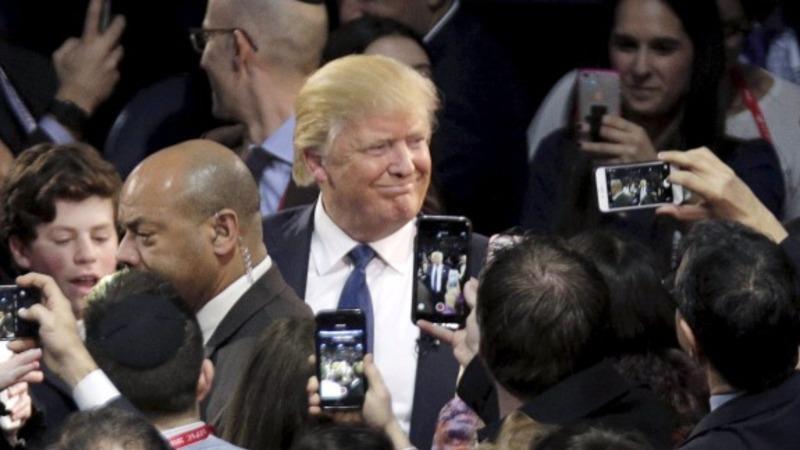 Trump defends campaign manager after arrest