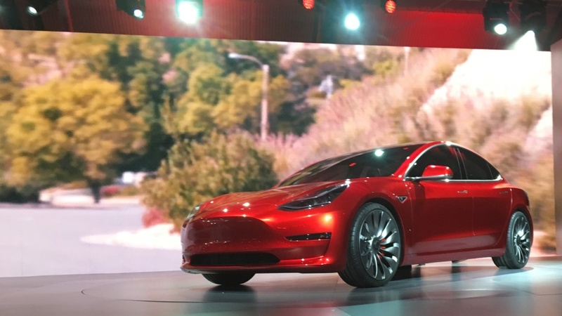 Tesla stock soars on preorders