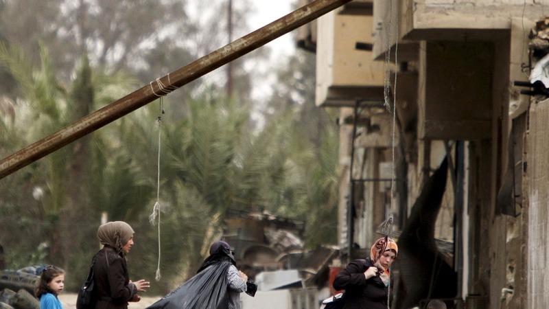 Palmyra residents return to broken city