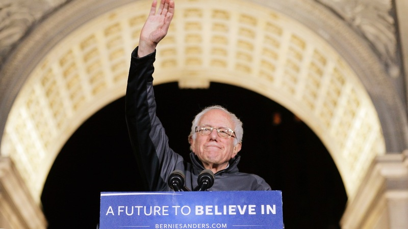 Sanders rides a surge into New York debate