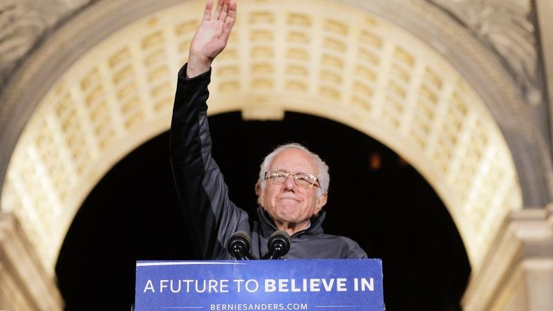 Sanders rides a surge into New York debate