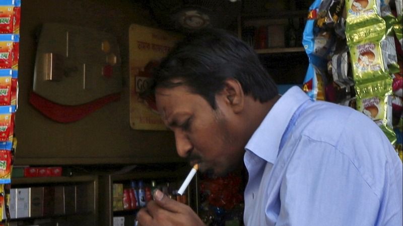 Tobacco firms fight India over new label rule