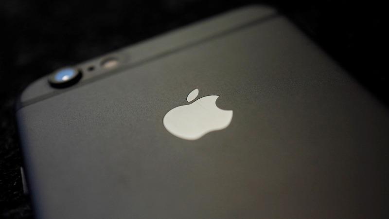Apple shares sink as iPhone worries return
