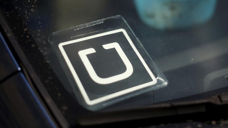 Uber settles $100M lawsuit over driver status