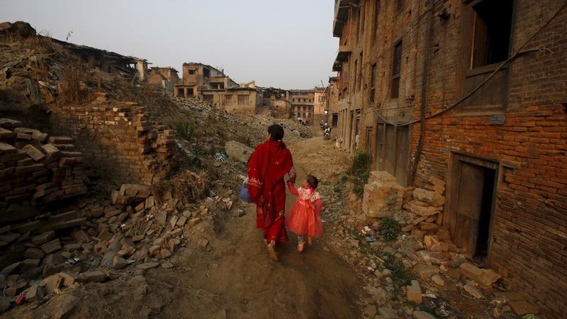 Nepali quake survivors rebuild homes a year on