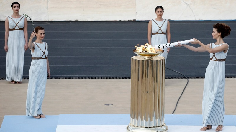 INSIGHT: Olympic flame on road to Rio