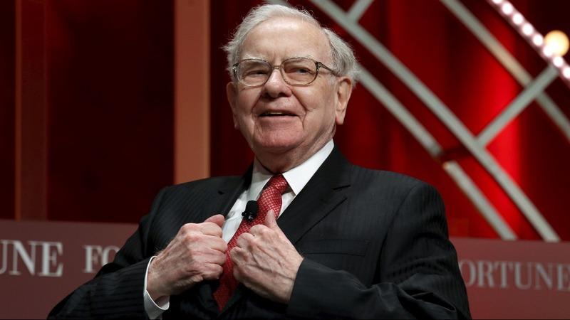 INSIGHT: Media swarm Warren Buffett