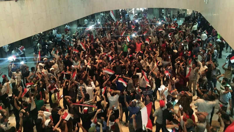 Chaos in Baghdad as protesters storm parliament