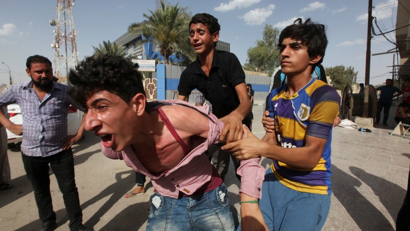 Suicide blasts in Iraq the day after a mass protest