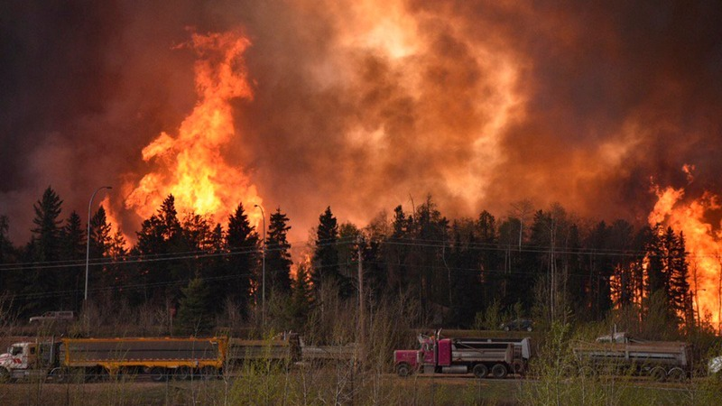 INSIGHT: Thousands flee Canada wildfire