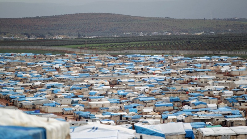Strike on Syrian refugee camp kills dozens