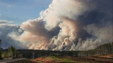 Wildfire forces thousands to move again