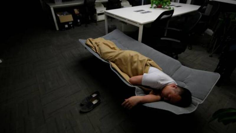 China's techies sleep on the job to get ahead