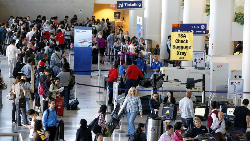 Homeland Security under fire for long airport lines