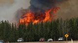 Wildfire shifts back toward Canada's oil producers