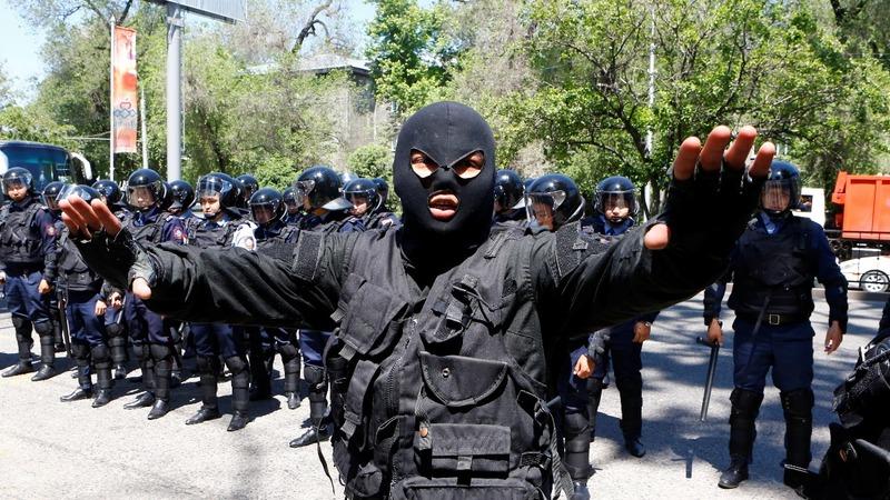 Kazakh police break up anti-government protests