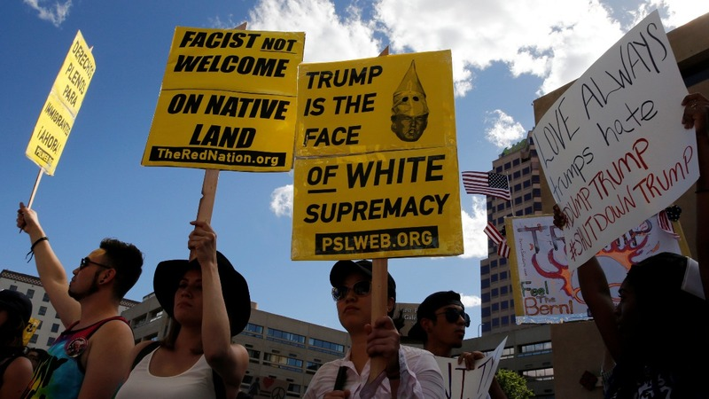 Police outnumber protesters outside Trump California rally