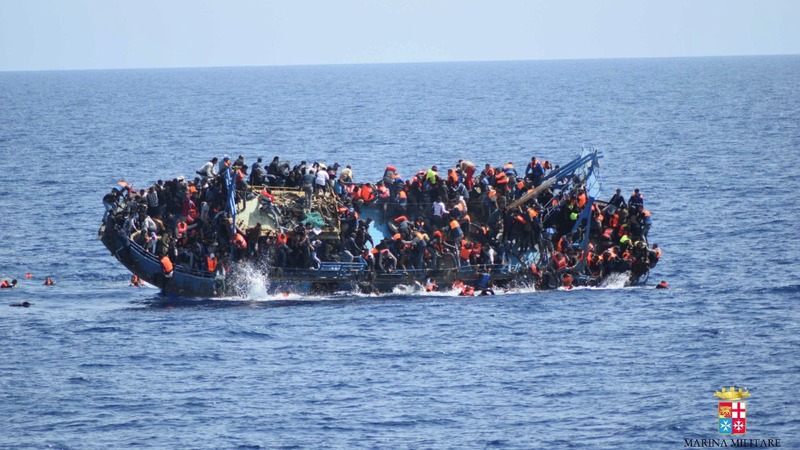 Terrifying moment as migrant ship flips