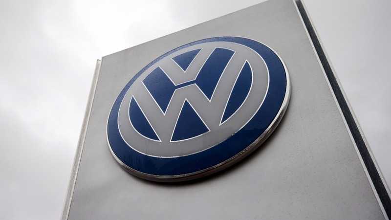 VW posts surprise profit gain