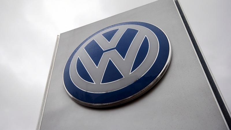 VW posts surprise profit gain