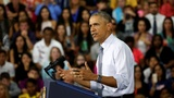 Obama touts economic record to bash Trump