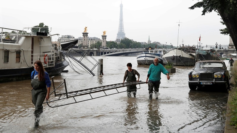 INSIGHT: Deadly floods hit France and Germany