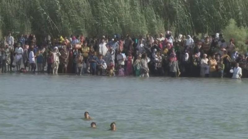 Falluja's civilians risk dangerous river escape
