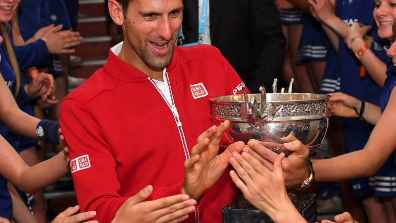 INSIGHT: Djokovic shows off French Open trophy
